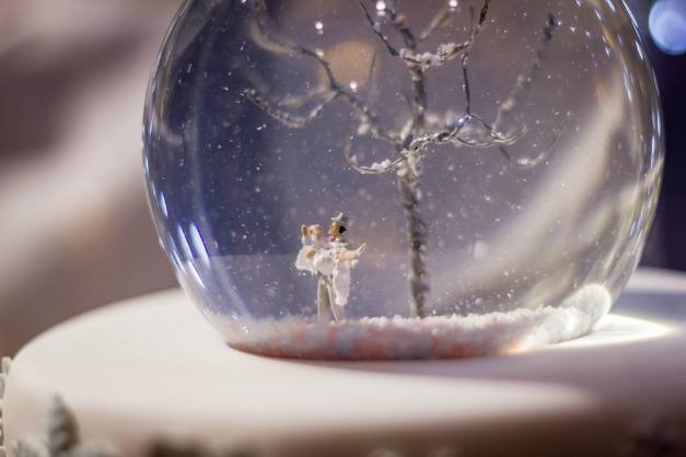 aCustom snow globe cake topper